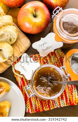 Homemade apple butter and freshly baked bread on the table.