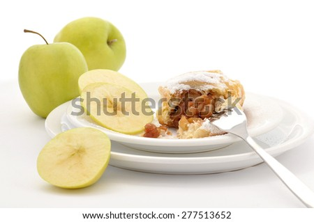 Homemade apple pie on white background with apple slices - stock photo