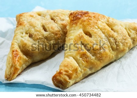 Homemade Apple Turnovers / Pastry with apple filling, selective focus