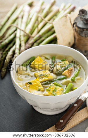 Homemade asparagus and frittata soup with small pasta - stock photo