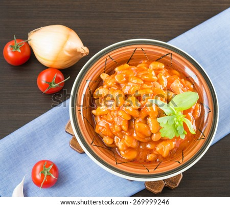 Homemade Baked Beans with tomato sauce in a bowl - stock photo