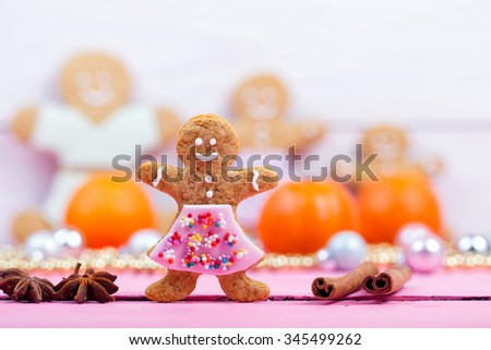 Homemade baked Christmas gingerbread tree on vintage wooden background. Anise, cinnamon and decoration utensils. - stock photo