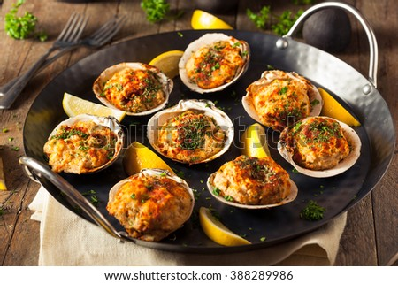 Homemade Baked Clams with Lemon and Parsley - stock photo