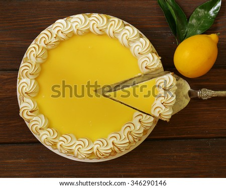homemade baked lemon tart cake with meringue cream - stock photo