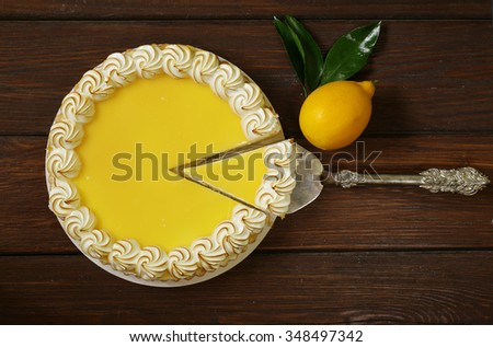 homemade baked lemon tart cake with meringue cream - stock photo