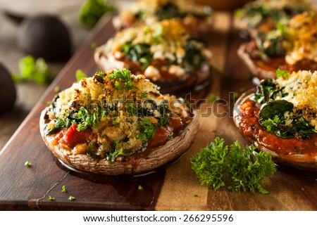 Homemade Baked Stuffed Portabello Mushrooms with Spinach and Cheese - stock photo