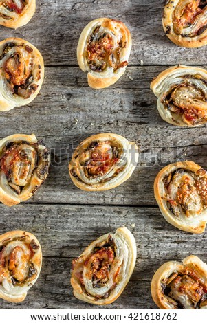 Homemade baking concept - french pastry buns snack with spicy mushroom stuffing, flat lay from above - stock photo