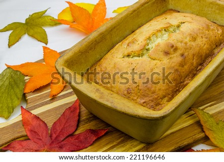 Homemade banana bread in pottery clay loaf pan - stock photo