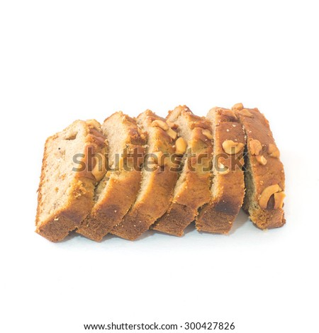 Homemade Banana Nut Bread Cut into Slices on white background  - stock photo
