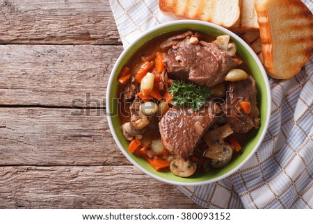 Homemade Beef Bourguignon in a bowl on the table. horizontal view from above