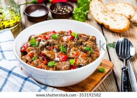 homemade beef stew with mushrooms and paprika. rustic style. - stock photo