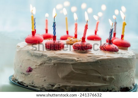 Homemade birthday cake with burning candles - stock photo
