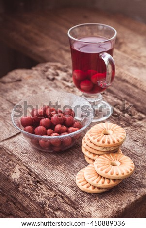 homemade biscuits with eggs and cream, Round cookies with a hole in a middle cherry lemonade in the glass on the wooden background.