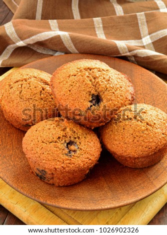 Homemade blueberry bran muffins in vintage bakeware and shot in natural light
