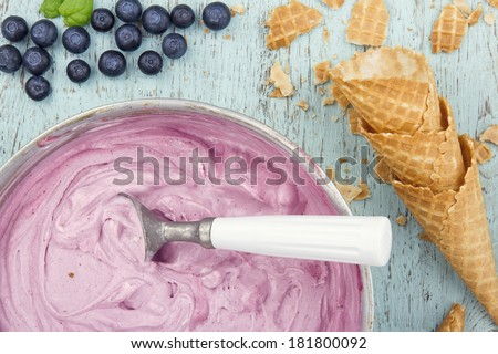 Homemade blueberry ice cream on vintage light blue wooden background - stock photo