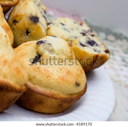 Homemade Blueberry Muffins on a White Plate. - stock photo
