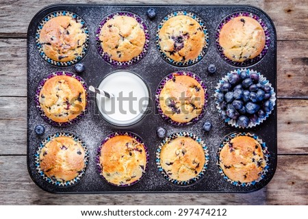 homemade blueberry muffins with milk and berries in baking dish - stock photo