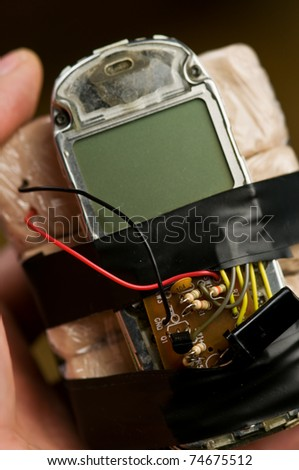 homemade bomb with mobile phone closeup - stock photo