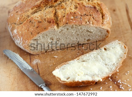 homemade bread with butter - stock photo
