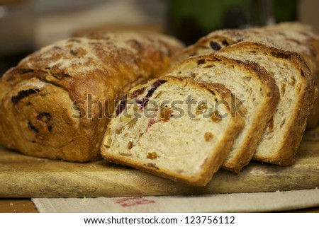 Homemade bread with dry fruits, cinnamon and nuts - stock photo