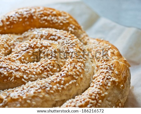 Homemade bread with sesame seeds, close