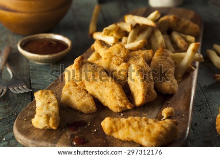 Homemade Breaded Chicken Tenders with Fries and BBQ Sauce - stock photo