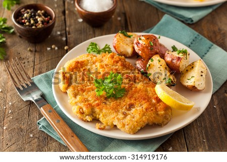 Homemade Breaded German Weiner Schnitzel with Potatoes - stock photo