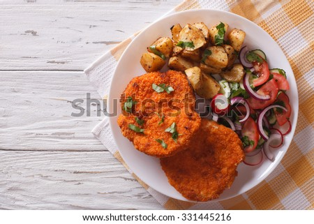 Homemade breaded German Weiner schnitzel with potatoes. horizontal view from above