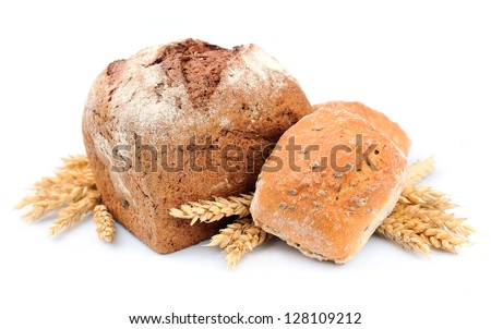 Homemade breads with wheat on wooden background - stock photo