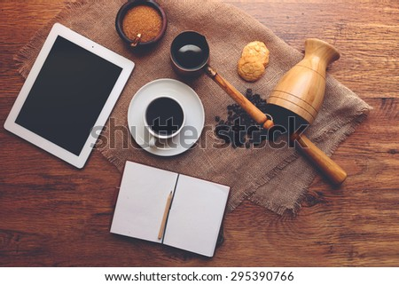 Homemade breakfast is on the table plate and diary with records of the meetings, a number of fragrant cup of fresh coffee and cookies - stock photo