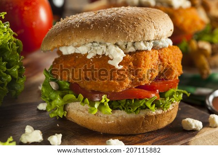 Homemade Buffalo Chicken Sandwich with Hot Sauce and Blue Cheese - stock photo