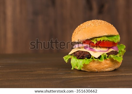 Homemade burger on the wooden table - stock photo
