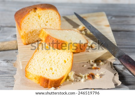 Homemade cake lemon cut on a cutting board - stock photo