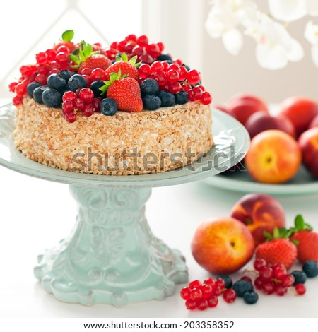Homemade cake with chocolate, nuts and fresh berries, selective focus - stock photo