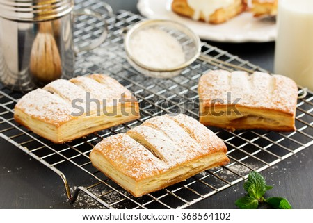 Homemade cakes and puff pastry with apples and caramel. - stock photo