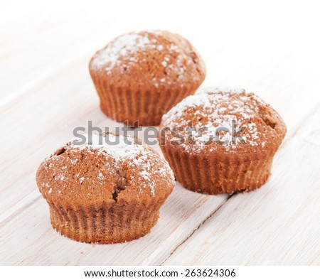 Homemade cakes on white wooden table - stock photo