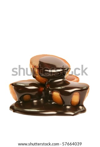 Homemade candies covered in chocolate sauce. - stock photo