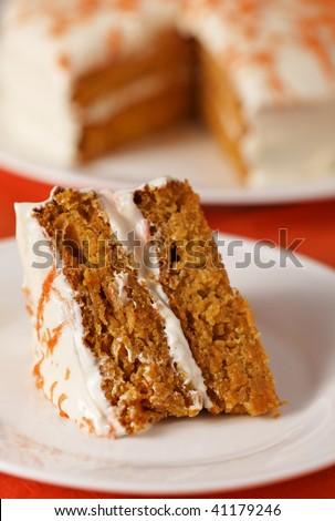 Homemade carrot cake dessert on white plate.Very shallow depth of field. - stock photo