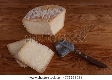 Homemade cheese on a wooden background