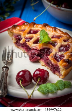 Homemade cherry pie on blue background. Selective focus.