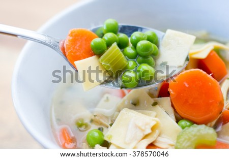 homemade chicken noodle soup in a white bowl
