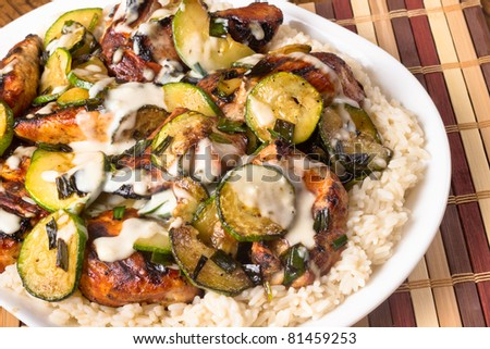 Homemade chicken with zucchini served over rice