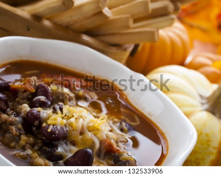 Homemade chili with ground turkey meat in white bowl. - stock photo