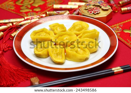 homemade chinese gold ingot dumplings, new year food, spring festival food  - stock photo