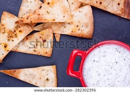 homemade chips with yogurt - stock photo