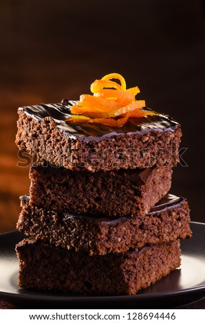 Homemade Chocolate Brownie on a dark plate against a dark background - stock photo