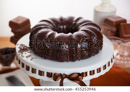 Homemade chocolate cake fresh baked candy bars ingredients beautiful decoration table - stock photo