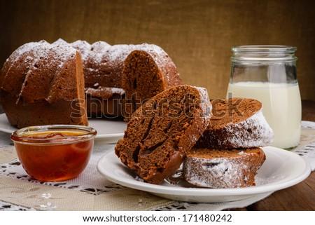 Homemade chocolate Cake, jam and milk - stock photo