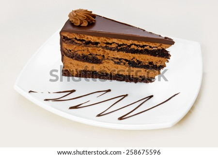 Homemade chocolate cake with cut piece - stock photo