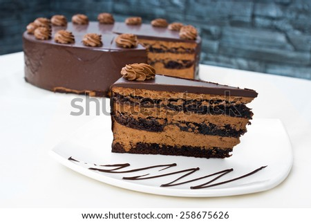 Homemade chocolate cake with cut piece - stock photo